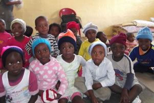 Samkelokuhle ECD Centre children wearing their new hats